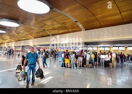 Cartagena Colombia Aeropuerto Internacional Rafael Nunez Airport inside concourse terminal Hispanic airline ticket counter lines queues man woman carr - Stock Image