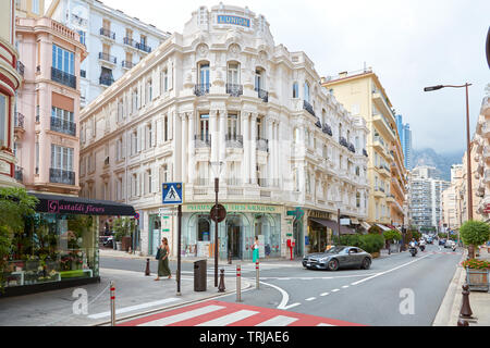 MONTE CARLO, MONACO - AUGUST 19, 2016: Ancient luxury buildings and people in a summer day in Monte Carlo, Monaco. - Stock Image