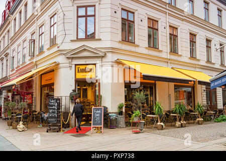 14 September 2018: Gothenburg, Sweden - Woman entering Konditori Restuarant or coffee shop. - Stock Image