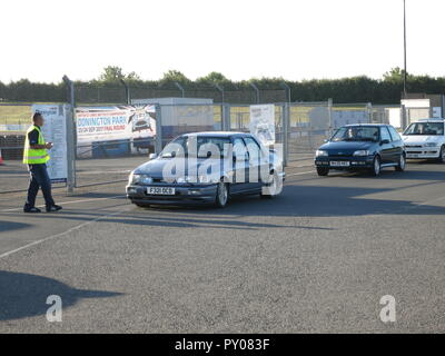 Ford RS sierra cosworth 4x4 and fiesta rs1800 shown at donnington park race circuit at the RS owners club national day - entering show ground with ticket marshall - Stock Image