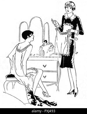 A maid and her mistress consider an undergarment       Date: 1927 - Stock Image