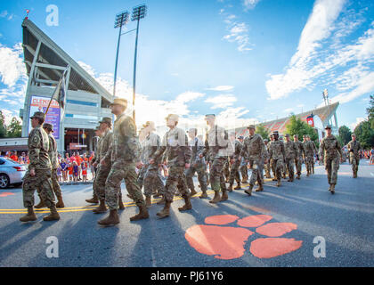 A formation of Clemson University Army ROTC cadets marches past the main gate of Memorial Stadium during the 2018 First Friday parade, August 31, 2018. (Photo by Ken Scar) - Stock Image