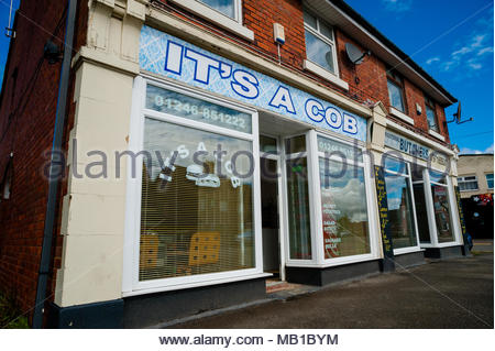 It's A Cob, a small unusual named cafe or small business on the High Street using a play on words as its title in Holmewood, Chesterfield, England UK - Stock Image
