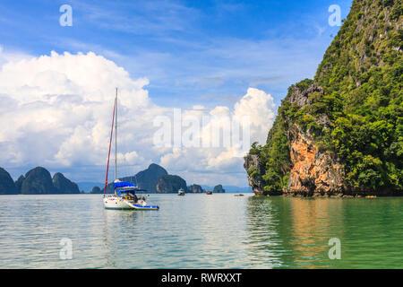 Yacht at anchor in Phang nga bay, Phuket, Thailand - Stock Image