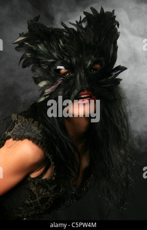 Girl in a Black Cat Mask. - Stock Image