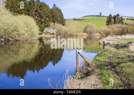The calm waters River Quoile on the outskirts of Downpatrick in County Down, Northern Ireland taken in early afternoon on a spring day in April 2019 - Stock Image