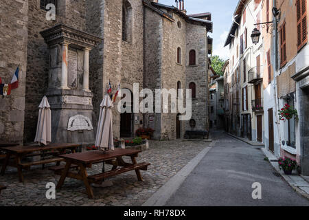 Street with War Memorial in the walled town of Colmars des Alpes, France - Stock Image