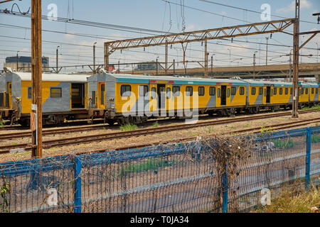 Metrorail train in yard station, in the suburbs of Joburg, South Africa - January 17, 2019 - Stock Image