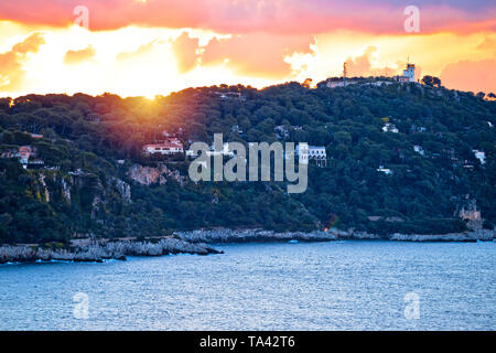 Cap Ferrat peninsula sunset view from Villefranche sur Mer, amazing scenery of French riviera, Alpes Maritimes department of France - Stock Image