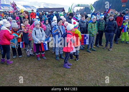 Children fans during ski jumping world cup competition in Ljubno ob Savinji. Stajerska, Slovenia. - Stock Image