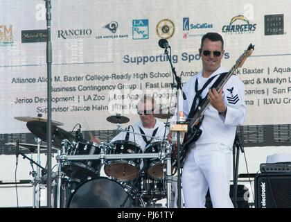 "180831-N-AA175-1040 LOS ANGELES (August 31, 2018) Musician 1st Class Mark Lane, right, and Musician 3rd Class Josh Smith, members of the Navy Band Southwest rock band known as the ""Destroyers,"" perform during Los Angeles Fleet Week (LAFW). LAFW is an opportunity for the American public to meet their Navy, Marine Corps and Coast Guard teams and experience America's sea services.  During fleet week, service members participate in various community service events, showcase capabilities and equipment to the community, and enjoy the hospitality of Los Angeles and its surrounding areas.  (U.S. Navy  - Stock Image"