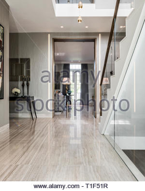 Tiled hallway in modern house - Stock Image