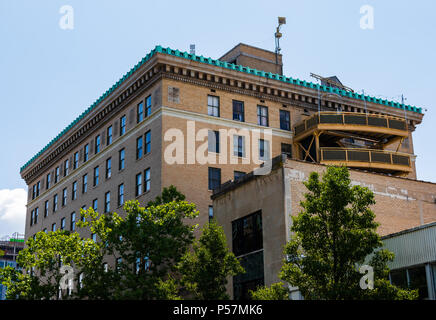 ASHEVILLE, NC, USA-24 JUNE 18: The rear of the 1926 flatiron building, a retail and office building at Battery Park and Wall Streets. - Stock Image