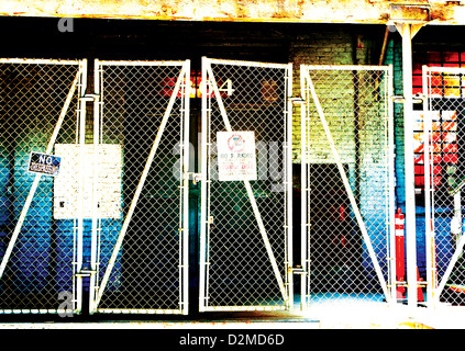 chain link fence across back of building - Stock Image