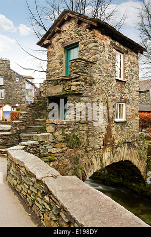 The Bridge House in Ambleside a grade one listed building and famous landmark in the English Lake District - Stock Image