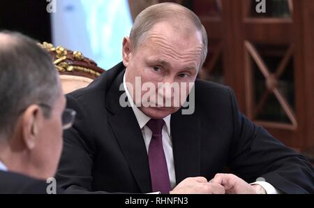 Moscow, Russia. 02nd Feb, 2019. Russian President Vladimir Putin listens to Foreign Minister Sergey Lavrov during a meeting along with Defense Minister Sergei Shoigu at the Kremlin February 2, 2019 in Moscow, Russia. The meeting discussed the Treaty on the Elimination of Intermediate-Range and Shorter-Range Missiles, after the United States announced their plan to withdraw from the disarmament agreement in place since 1988. Credit: Planetpix/Alamy Live News - Stock Image