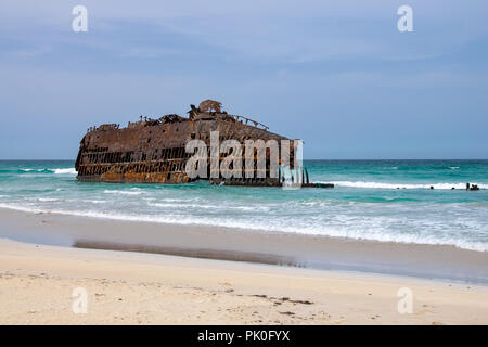 Rusting shipwreck cabo Santa Maria stranded on the northern coast of Boa Vista, Cape Verde - Stock Image
