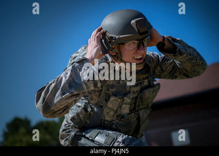 U.S. Air Force Staff Sgt. Anthony Zygmunt, 7th Reconnaissance Squadron alarm monitor, performs physical exercises prior to firing during Air Combat Command's Defender Challenge team selection at Joint Base Langley-Eustis, Virginia, Aug. 24, 2018. The team candidates performed a variety of physical exercises prior to firing the M4 carbine and M9 pistol during the selection. (U.S. Air Force photo by Staff Sgt. Areca T. Bell) - Stock Image