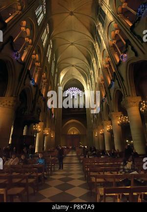 Inside of the famous cathedral Notre Dame de Paris. - Stock Image