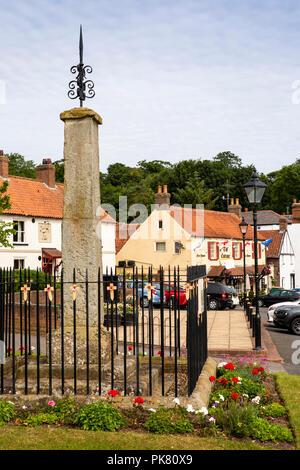 UK, England, Yorkshire, Filey, Hunmanby, Bridlington Street, market Cross on village green - Stock Image