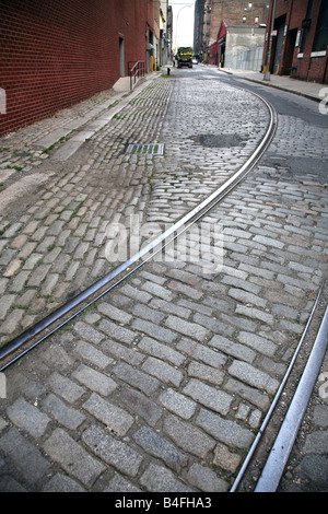 Old trolley tracks on a cobblestone street in Dumbo, Brooklyn, NY, USA - Stock Image