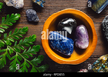 Crystals of Sagittarius including, Sodalite, Snowflake Obsidian, Amethyst, Lapis Lazuli, Labradorite, Ruby in Matrix, Iolite and Azurite - Stock Image