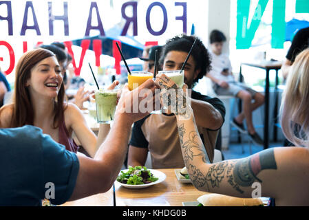 Friends drinking juice together - Stock Image