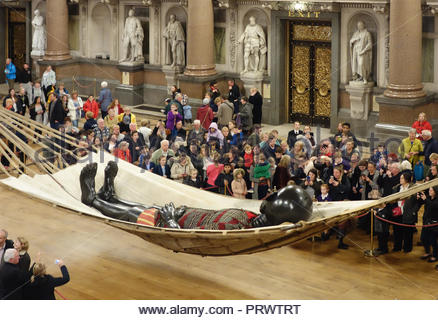 Liverpool, UK. 4th October, 2018. The Little Boy Giant from French street theatre company Royal de Duxe on display at St.George's Hall, Liverpoolon on Thursday afternoon, 4th October, 2018. Thousands turned up to view the Giant asleep on a hammock at the start of a 4 day Giant spectacular in Liverpool. Credit: Pak Hung Chan/Alamy Live News - Stock Image