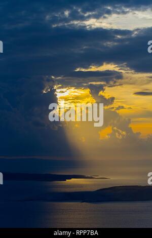 Pag island Dalmatia Croatia late afternoon clouds with sun peering through - Stock Image