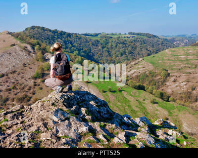 Peak District National Park, Derbyshire, UK. 10th October, 2018. UK Weather woman admiring the view on the top of Thorpe Cloud on a unusually hot sunny October day in the tourist hotspot of Dovedale in the Peak District National Park, Derbyshire Credit: Doug Blane/Alamy Live News - Stock Image