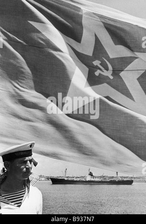 A Soviet banner waving on a warship off the Cuban shore - Stock Image
