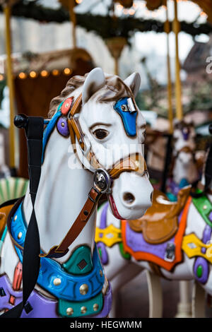 Painted wooden horses on a carousel - Stock Image