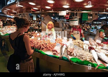 Spain Barcelona Market hall Mercat de la Boqueria fresh fish seefood saleswoman - Stock Image