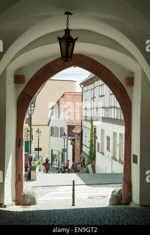 Side street viewed through an arch - Stock Image