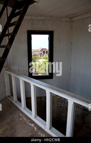 View of Fort Jefferson grounds from within the lighthouse at Bastion C through the stairwell window-Dry Tortugas - Stock Image