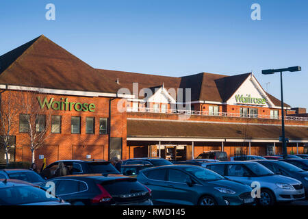The Waitrose supermarket with parked cars in Henley-on-Thames, Oxfordshire. - Stock Image