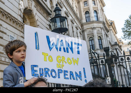 London, UK. 20th October 2018. A young boy holds a poster 'I want to grow up European' at the entrance to Downing St at the end of the People's Vote March calling for a vote to give the final say on the Brexit deal or failure to get a deal. They say the new evidence which has come out since the referendum makes it essential to get a new mandate from the people to leave the EU. With so many on the march the crowding meant many failed to reach Parliament Square and came to a halt in Whitehall. Peter Marshall/Alamy Live News - Stock Image