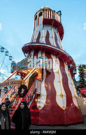 The 'Wonderful Helter Skelter' in the Christmas Market in George Square, Glasgow, UK, with a Big Wheel in the background. - Stock Image