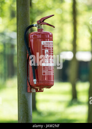 Fire extinguisher mounted on campsite, Bodstedt,  Baltic Sea, peninsula of Fischland-Darß-Zingst, Zingst, Mecklenburg - Stock Image