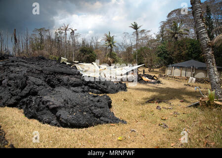 A home in the Leilani Estates destroyed by a lava flow from the eruption of the Kilauea volcano May 19, 2018 in Pahoa, Hawaii. - Stock Image