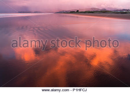 Purple sunset over New Brighton beach on rainy day, Christchurch, New Zealand - Stock Image