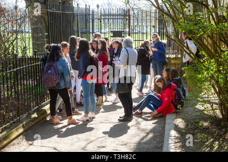A school party on a guided tour in Grove Walk, Oxford by Christ Church Meadow - Stock Image