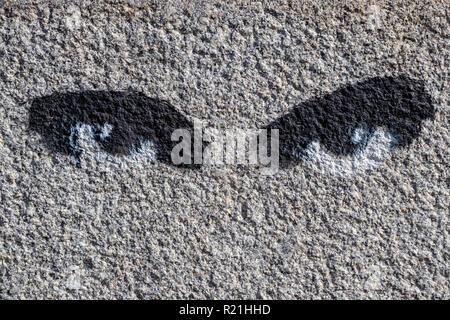 painted eyes spy symbol on graffiti wall Ukraine Kiev 06.11.2018 - Stock Image