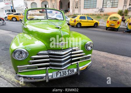 Cuba, Havana. Lime-green classic taxi. Credit as: Wendy Kaveney / Jaynes Gallery / DanitaDelimont.com - Stock Image