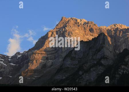 Sunset Scene at Lake Kloental, Glarus Canton. Mount Glaernisch. - Stock Image