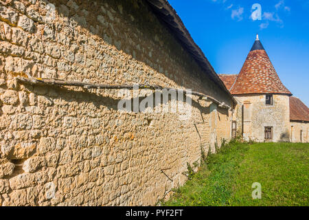 Long fire pole on wall of Chateau Boussay outbuildings - France. - Stock Image