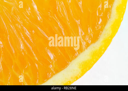 A partial cross section of an orange slice on white. - Stock Image