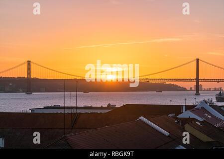 25 de Abril Bridge at sunset, Lisbon, Portugal - Stock Image