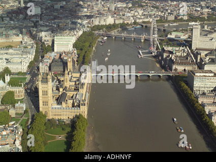 Aerial view of the Houses of Parliament, River Thames and the London Eye also showing Westminster Bridge and Big Ben Clock Tower - Stock Image