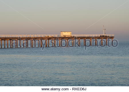 Wood Pier in England at sundown - Stock Image